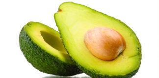 Плод авокадо разрезаный на пополам